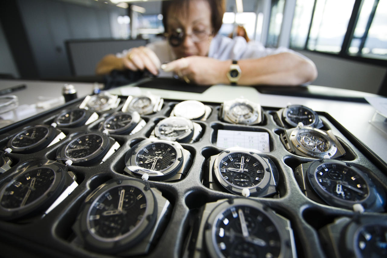 A woman works on a Hublot watch at the Swiss watchmaker manufacture in Nyon November 5, 2009. REUTERS/Valentin Flauraud (SWITZERLAND BUSINESS)