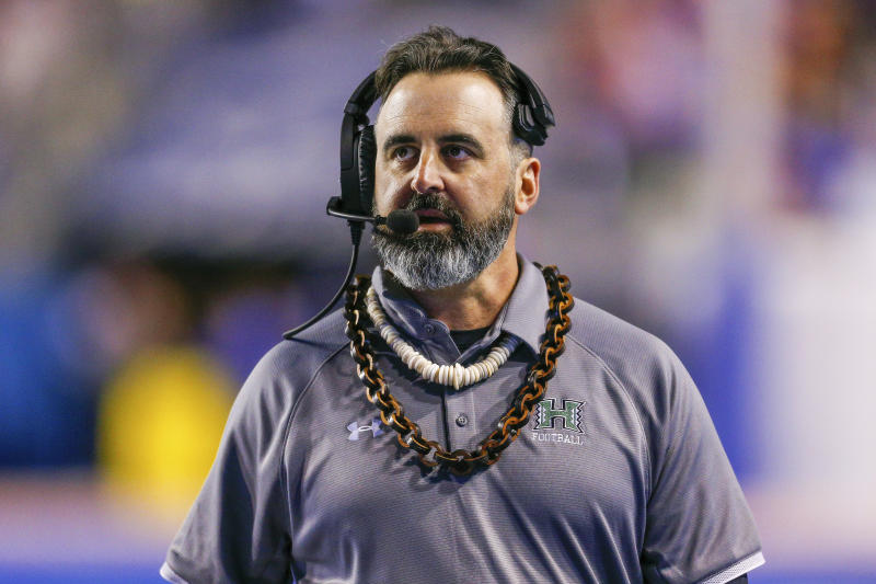 FILE - In this Saturday, Oct. 12, 2019, file photo, Hawaii head coach Nick Rolovich walks the sideline during the second half of an NCAA college football game against Boise State, in Boise, Idaho. Washington State is close to finalizing an agreement with Rolovich to take over as the Cougars' head football coach, according to two people with knowledge of the situation. (AP Photo/Steve Conner, File)