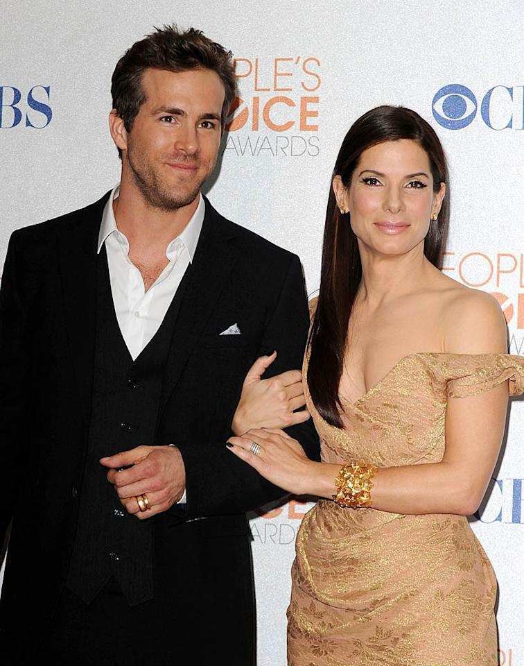 """Yes, They're Together!"" declares the cover of <i>OK!</i>, referring to Sandra Bullock and Ryan Reynolds. After reporting how ""The Proposal"" co-stars spent an ""intimate"" New Year's Eve at Bess Bistro in Austin, Texas, the mag notes, ""Sandra was glued to Ryan's every word, they sure seemed to be taken with each other."" For how serious the two newly single stars have become, check out what Bullock's rep admits to <a href=""http://www.gossipcop.com/sandra-bullock-ryan-reynolds-bess-bistro-new-years-eve/"" target=""new"">Gossip Cop</a>. Steve Granitz/<a href=""http://www.wireimage.com"" target=""new"">WireImage.com</a> - January 6, 2010"