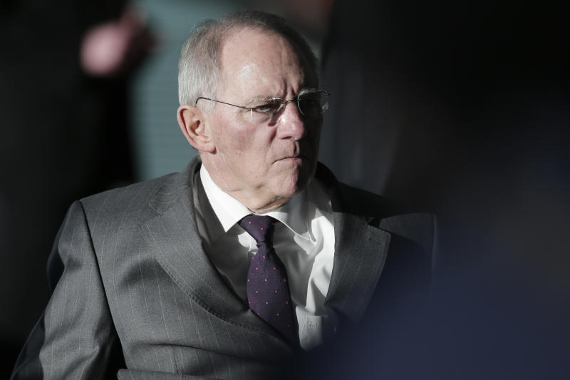 German Finance Minister Wolfgang Schaeuble arrives for the weekly cabinet meeting at the chancellery in Berlin, Germany, Wednesday, Feb. 6, 2013. The cabinet will discuss a new national law for bank regulations.  (AP Photo/Markus Schreiber)