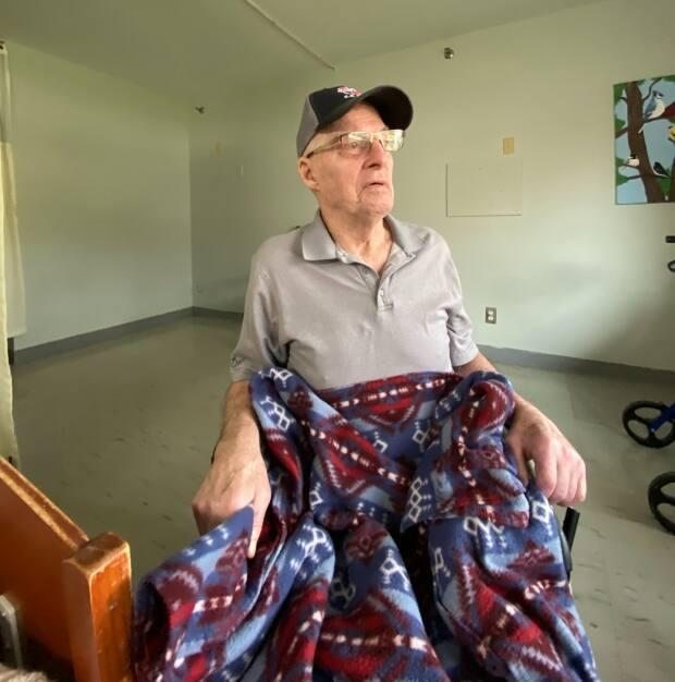 Cyril Mooney, 83, would often have the colourful blanket on his lap when he read, or when he was chilly. (Janice Mooney - image credit)
