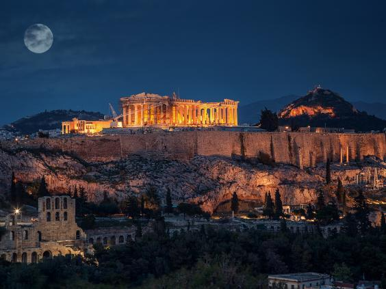 The Parthenon lit up at night is a spectacular sight (Getty)