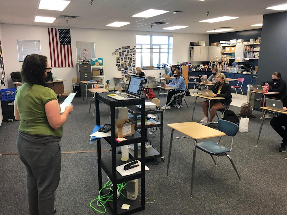Students meet in person to study anatomy and physiology at Bancroft-Rosalie. One remote learner joins the class on Zoom.