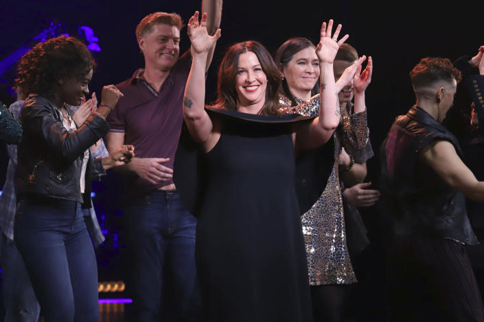 """Alanis Morissette, center, appears on stage during the """"Jagged Little Pill"""" Broadway opening night curtain call at the Broadhurst Theatre on Dec. 5, 2019, in New York. - Credit: Greg Allen/Invision/AP"""
