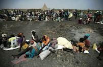 A large number of people wait for food air-drops by ICRC (International Committee of the Red Cross), outside Thonyor, in South Sudan, on February 3, 2016