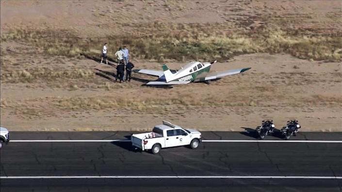 A helicopter collided with an airplane in the air above the Chandler Municipal Airport in Arizona early Friday morning, the Chandler Fire Department said. (KPNX)