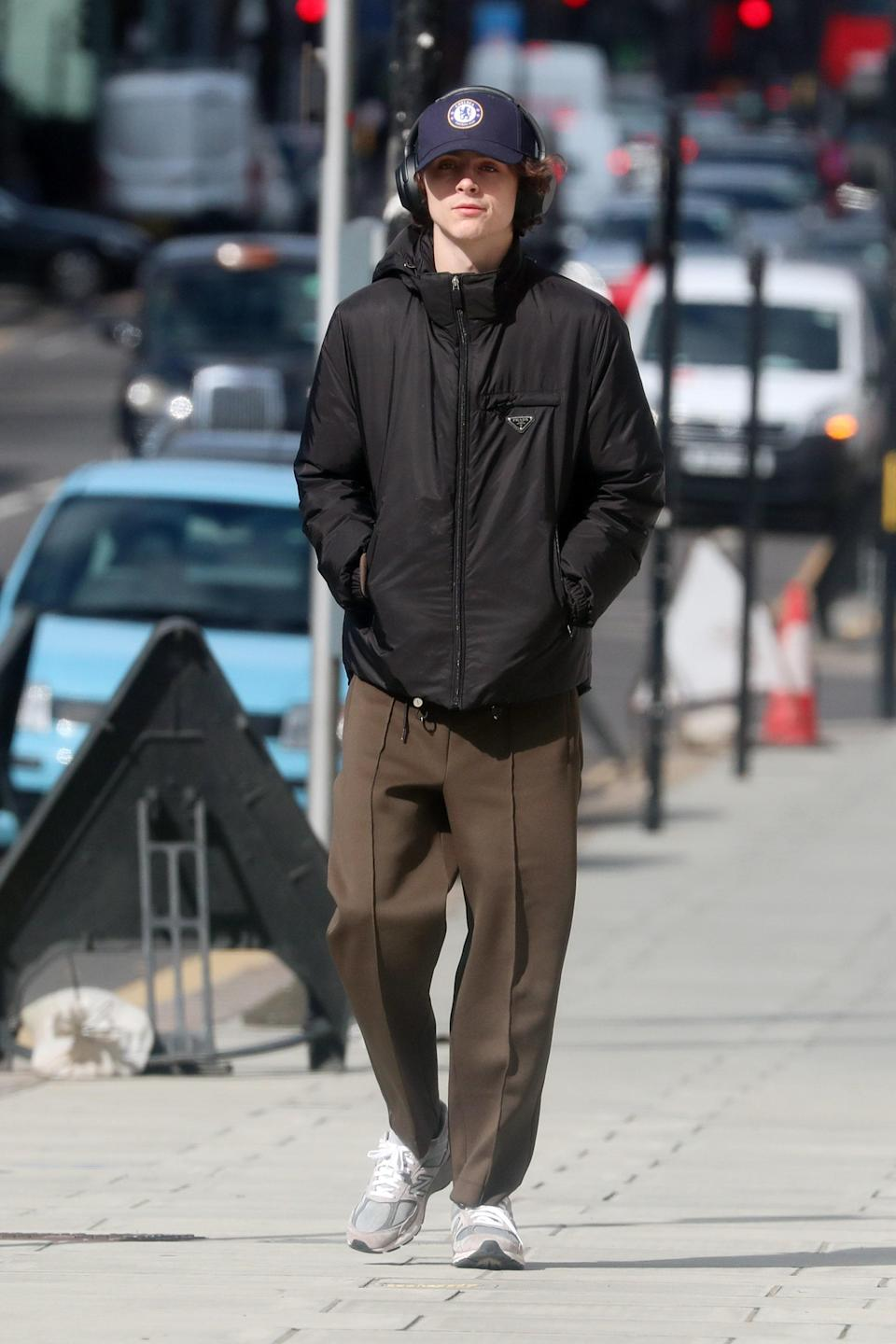 """<p>WHAT: A Prada jacket and New Balance sneakers</p> <p>WHERE: Walking in Notting Hill, London</p> <p>WHEN: March 16, 2020 </p> <p>WHY: In which Timothee Chalamet perfects the """"getting some air"""" fit. </p>"""