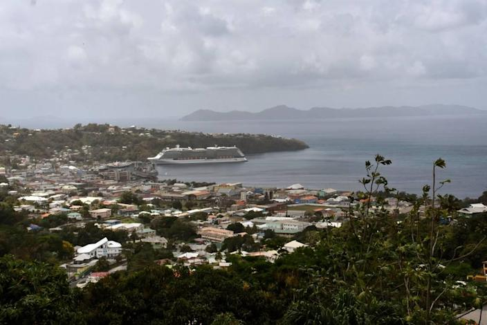 The Royal Caribbean cruise ship Reflection sits docked waiting to evacuate a group of British, Canadian and U.S. nationals in Kingstown, on the eastern Caribbean island of St. Vincent, Friday, April 16, 2021.