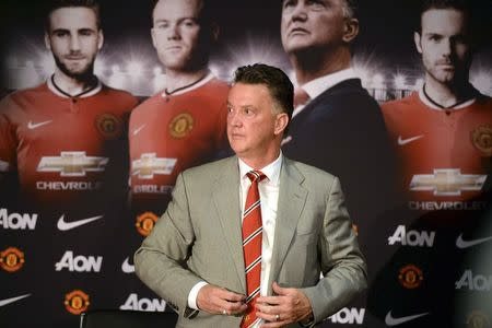 New Manchester United manager Louis Van Gaal attends a news conference at the club's Old Trafford Stadium in Manchester, northern England, July 17, 2014. REUTERS/Nigel Roddis/Files