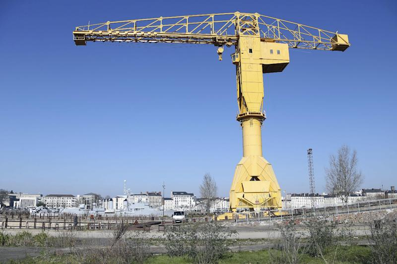 "View of the crane in which a French father who wants visiting rights with his young son is spending a fourth day atop a crane in protest, Monday, Feb,18, 2013. The man, Serge Charnay, wants France to strengthen its law on shared custody. He was convicted of taking his son on an unauthorized vacation for two months in 2011, and said he regretted nothing because ""if I hadn't I wouldn't have seen him."" (AP Photo/David Vincent)"