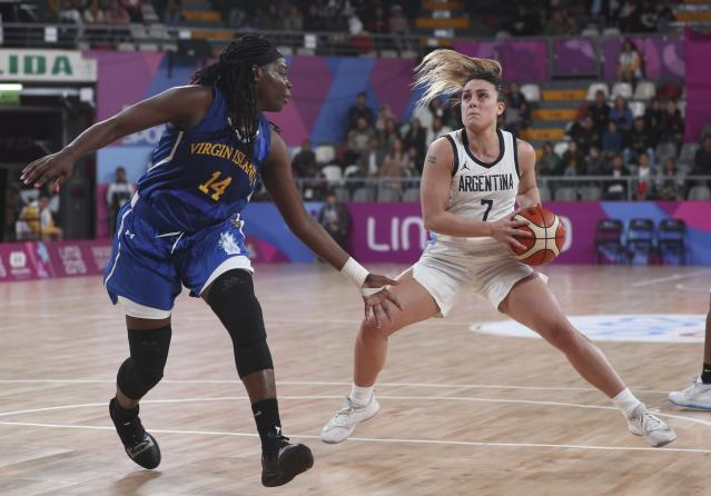 Julieta Ale of Argentina, right, pressures Anisha George, of the Virgin Islands during the women's basketball match at the Pan American Games in Lima, Peru, Thursday, Aug. 8, 2019. (AP Photo/Martin Mejia)