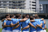 Members of Argentina's men's rugby sevens team huddle on the field during a practice at the Tokyo 2020 Olympics, in Tokyo, Friday, July 23, 2021. (AP Photo/David Goldman)