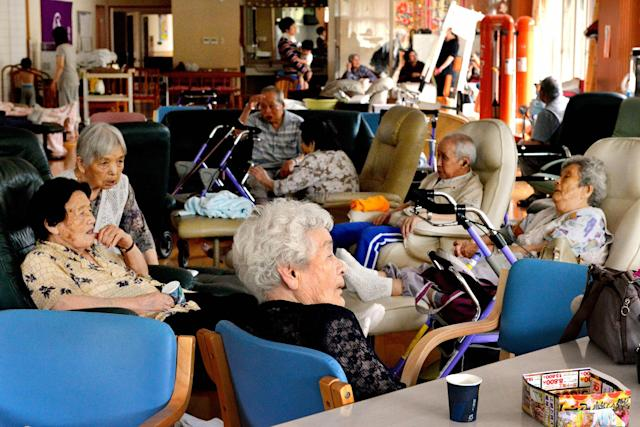 <p>Elderly people unable to return their houses after using a nursing home spend time in Toho, Fukuoka, Japan on July 6, 2017. (Photo: The Asahi Shimbun via Getty Images) </p>
