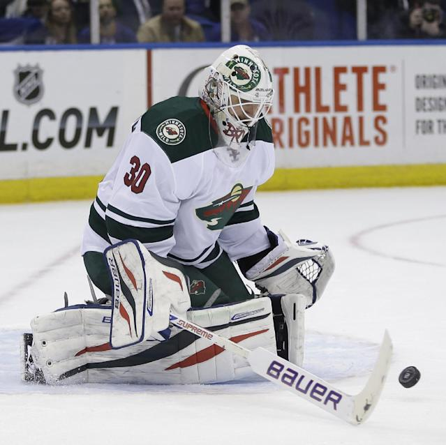 Minnesota Wild goalie Ilya Bryzgalov makes a save during the second period of the NHL hockey game against the New York Islanders, Tuesday, March 18, 2014, in Uniondale, New York. (AP Photo/Seth Wenig)