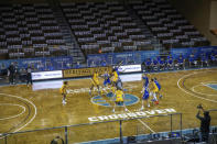 South Dakota State and West Virginia players go for the opening tip during an NCAA college basketball game Wednesday, Nov. 25, 2020, in Sioux Falls, S.D. (AP Photo/Josh Jurgens)
