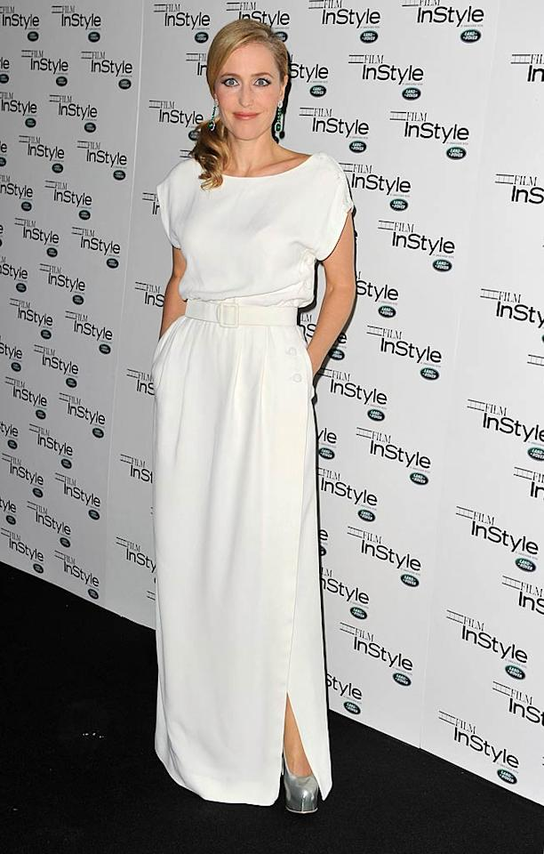 """We haven't seen much of actress Gillian Anderson lately, but we liked what we saw when the former """"X-Files"""" star hit the red carpet at <i>InStyle</i> magazine's 10th Anniversary party in London last week. The 43-year-old rocked a belted, floor-length vintage Christian Dior gown and some seriously silver platform heels. Her side-swept ponytail and dangling earrings gave her ensemble some extra drama. (11/22/2011)"""