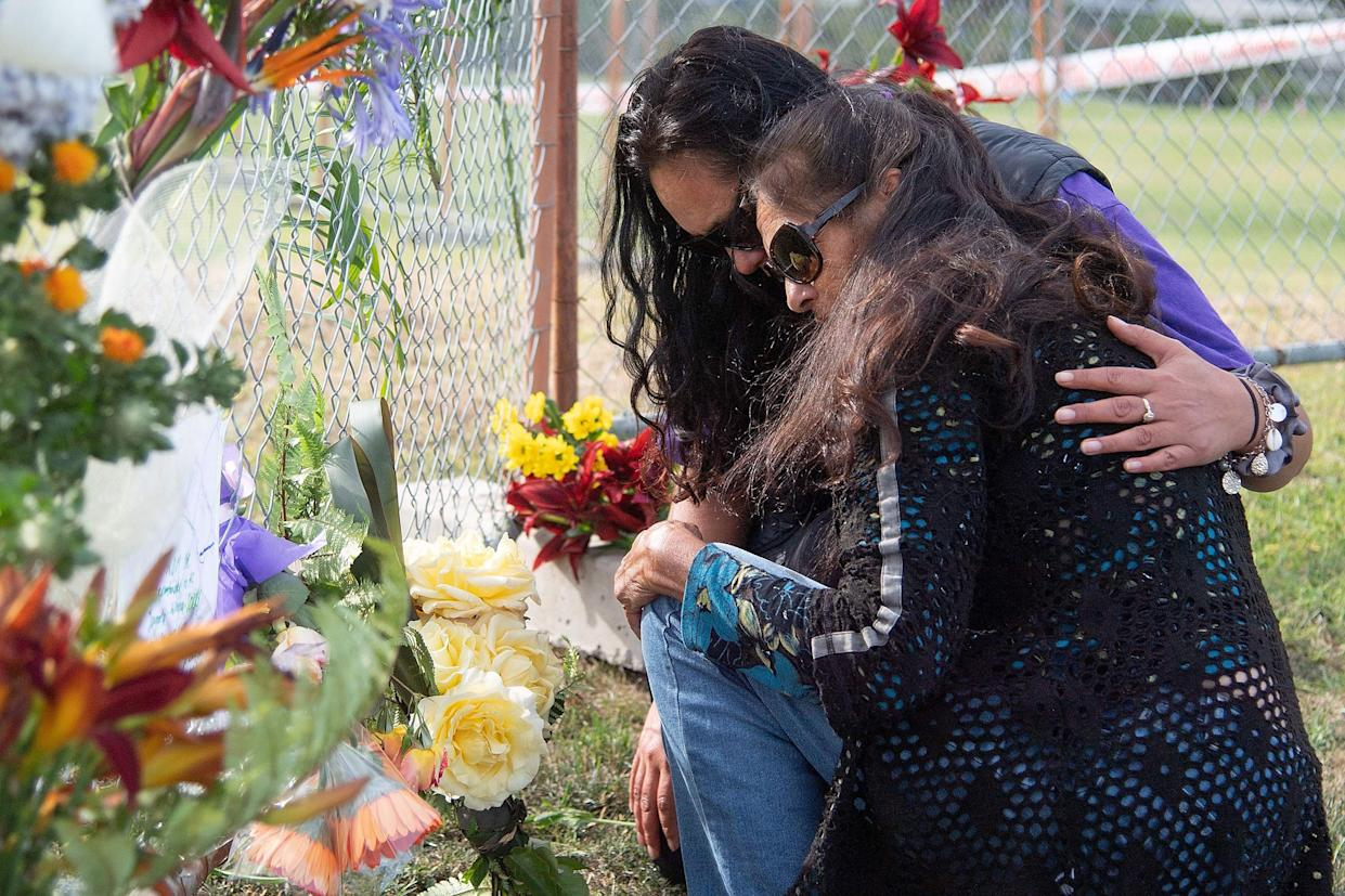 Image: Bouquets of flowers are placed on the waterfront near White Island Tours base in Bay of Plenty