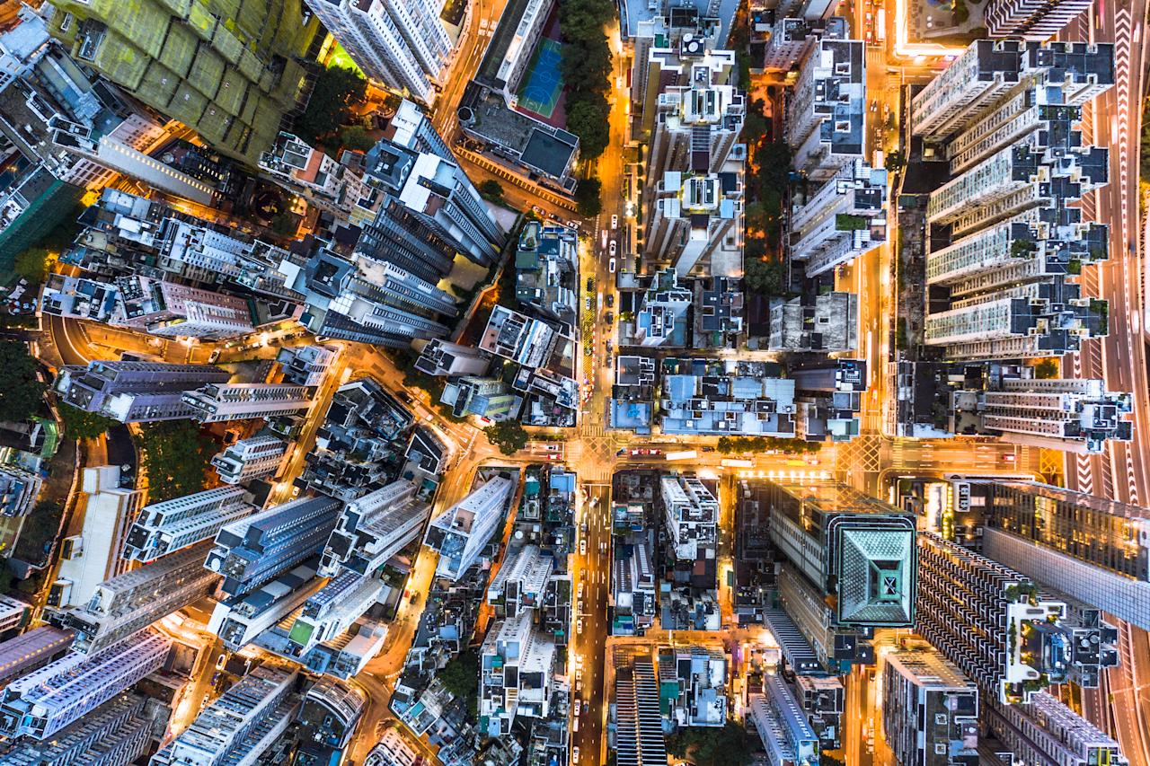 Stunning aerial view at night of the very crowded Hong Kong island streets, Shot above the Sai Yin Pun district