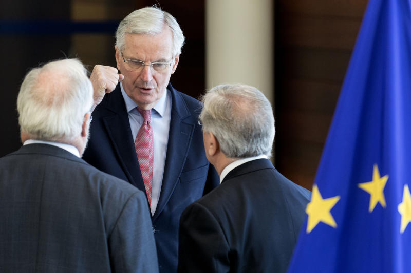 European Union chief Brexit negotiator Michel Barnier, center, speaks with EU Commissioner for Energy Miguel Arias Canete, left, and EU Commissioner for Maritime Affairs and Fisheries Karmenu Vella, right, during a meeting of the College of Commissioners at EU headquarters in Brussels, Thursday, Nov. 22, 2018. European Commissioners met Thursday in an extraordinary session at a critical stage in Brexit negotiations, ahead of a weekend EU summit focused on Britain's departure from the bloc. (AP Photo/Thierry Monasse)