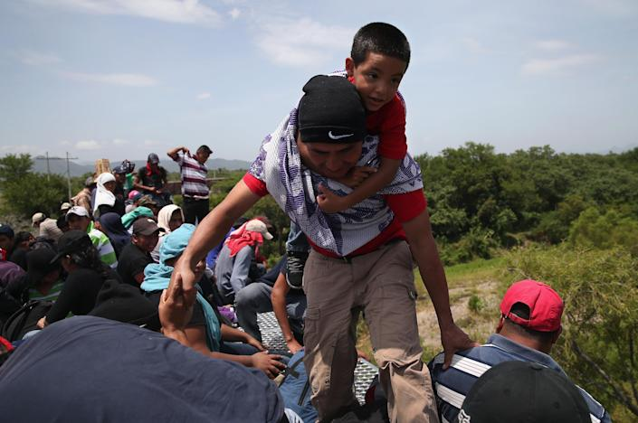 Central American immigrants travel on top of a freight train in Ixtepec, Mexico, Aug. 6, 2013. (Photo: John Moore/Getty Images)