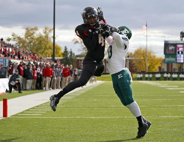 Northern Illinois wide receiver Da'Ron Brown (4) catches a touchdown pass in front of Eastern Michigan defensive back Quan Pace (33) during the first half of an NCAA college football game on Saturday, Oct. 26, 2013, in DeKalb, Ill. (AP Photo/Jeff Haynes)