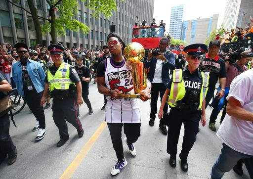 TORONTO, ON - JUNE 17: Kyle Lowry #7 of the Toronto Raptors walks down the street with the championship trophy during the Toronto Raptors Victory Parade on June 17, 2019 in Toronto, Canada. The Toronto Raptors beat the Golden State Warriors 4-2 to win the 2019 NBA Finals. (Photo by Vaughn Ridley/Getty Images)