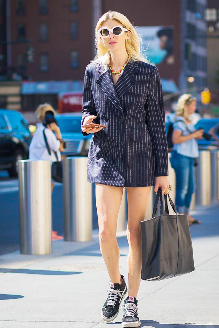 We love a good navy pinstripe but especially when the business-casual separate is given the streetwear treatment (sneakers and oversize sunglasses).