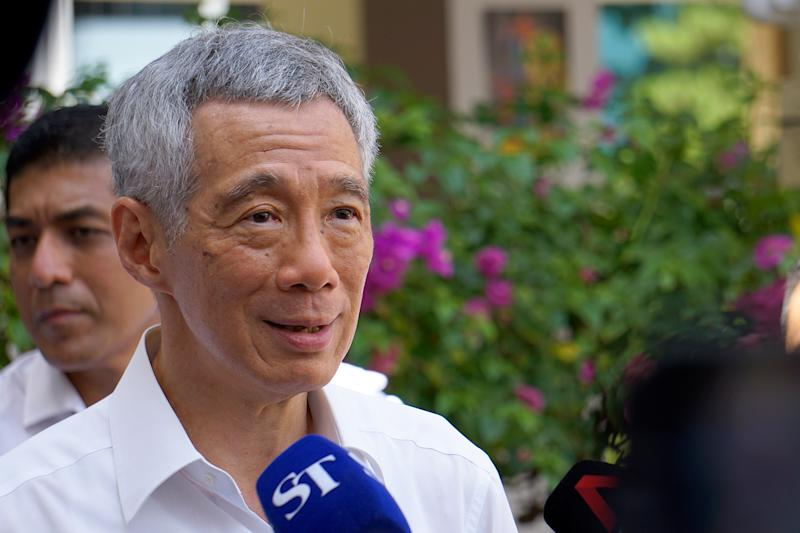 Prime Minister and PAP election candidate Lee Hsien Loong speaking to the media at Deyi Secondary School on Nomination Day (30 June). (PHOTO: Dhany Osman / Yahoo News Singapore)