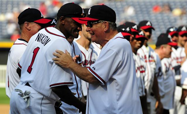 Former Atlanta Braves manager Bobby Cox greets Otis Nixon for a Braves Legends Game in 2011 (AP Photo/Dave Tulis)