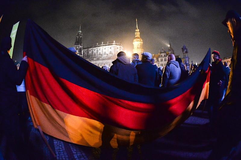 Supporters of the anti-Muslim PEGIDA movement rally on October 19, 2015 in Dresden, eastern Germany