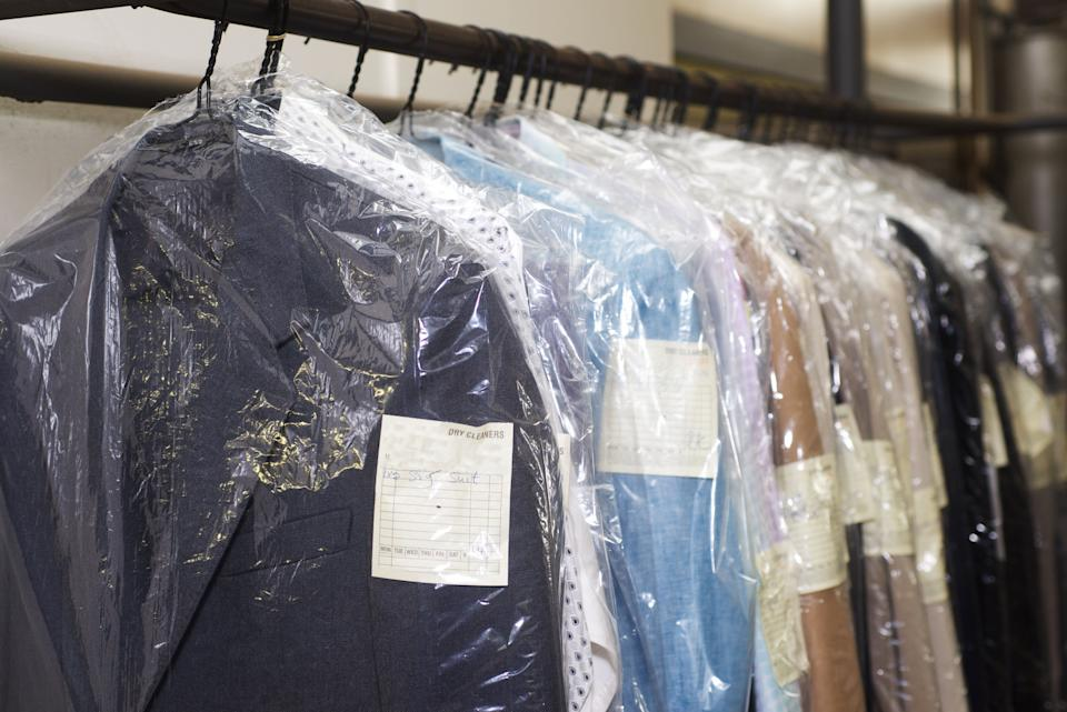 The chemicals used in dry cleaning don't kill viruses, but the heat applied during pressing and ironing can. (Photo: artwell via Getty Images)