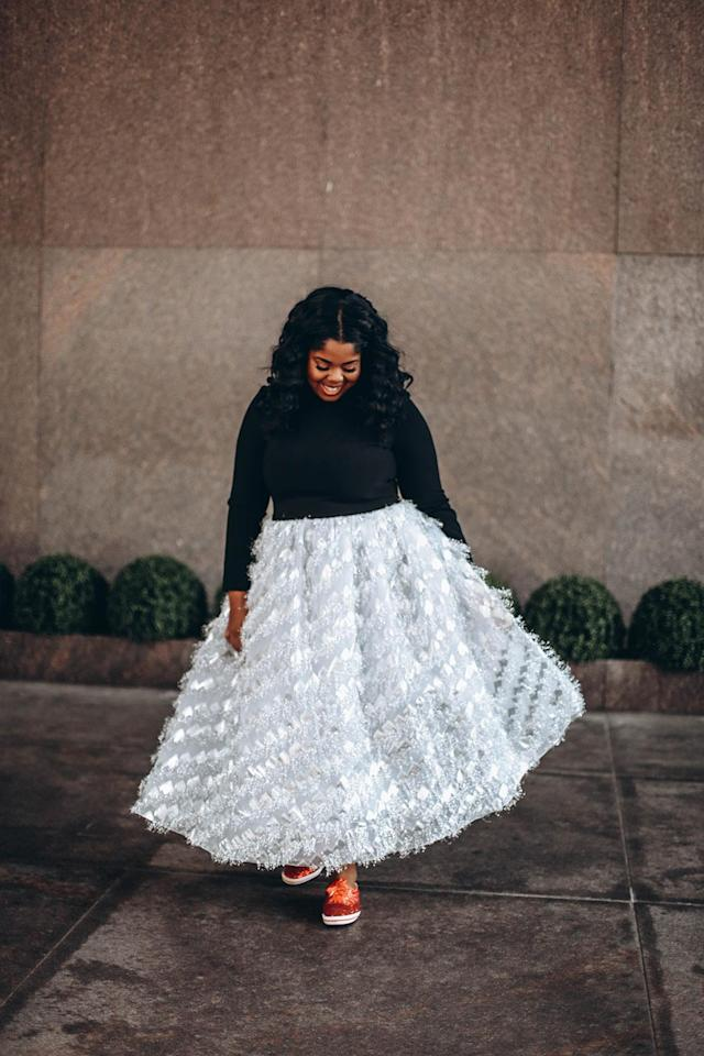 Hayet Rida wears a black sweater and embellished A-line skirt. (Photo: Courtesy of Hayet Rida)