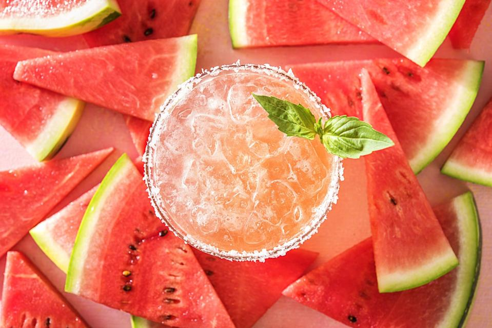 <p>We're digging this refreshing watermelon spin on the margarita that Hello Fresh created! You can reduce or increase the sugar according to your sweetness preferences.</p> <p><strong>Ingredients: </strong></p> <ul> <li>1.5 oz. tequila </li> <li>1 oz. lime juice </li> <li>1 oz. basil simple syrup (instructions below) </li> <li>2 oz. watermelon juice </li> <li>Lime wedge, salt, and basil for garnish</li> </ul> <p><strong>Directions:</strong> Add tequila, lime juice, basil simple syrup, and watermelon juice in a shaker with ice and mix well. Strain into an ice-filled glass, and garnish with basil and lime. You can also salt the rim if you want. For the basil simple syrup, combine all three ingredients over medium heat until the sugar dissolves. Cool and store for up to two weeks in the fridge.</p>