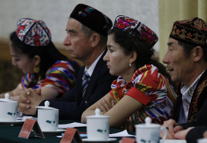 Delegates from China's Xinjiang Uygur Autonomous Region attend a meeting at the Great Hall of the People as part of the 18th Communist Party Congress in Beijing, China, Friday, Nov. 9, 2012. (AP Photo/Vincent Yu)