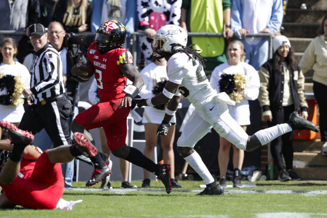 Maryland quarterback Tyrrell Pigrome (3) heads to the end zone for a touchdown in front of Purdue safety Cory Trice (23) during the first half of an NCAA college football game in West Lafayette, Ind., Saturday, Oct. 12, 2019. (AP Photo/Michael Conroy)