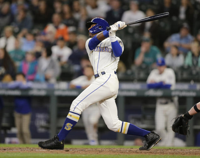 Seattle Mariners' Kyle Lewis hits a three-run home run on a pitch from Chicago White Sox relief pitcher Kelvin Herrera during the eighth inning of a baseball game Sunday, Sept. 15, 2019, in Seattle. (AP Photo/John Froschauer)