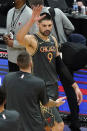 Chicago Bulls center Nikola Vucevic (9) celebrates with teammates after the Bulls defeated the Cleveland Cavaliers in an NBA basketball game in Chicago, Saturday, April 17, 2021. (AP Photo/Nam Y. Huh)