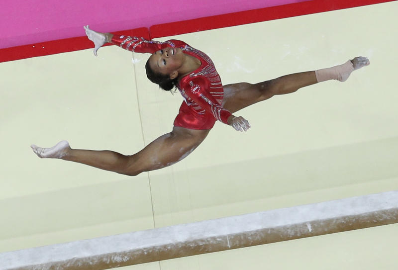 FILE - In this July 31, 2012 photo, U.S. gymnast Gabrielle Douglas performs on the balance beam during the Artistic Gymnastic women's team final at the 2012 Summer Olympics, in London. (AP Photo/Julie Jacobson, File)