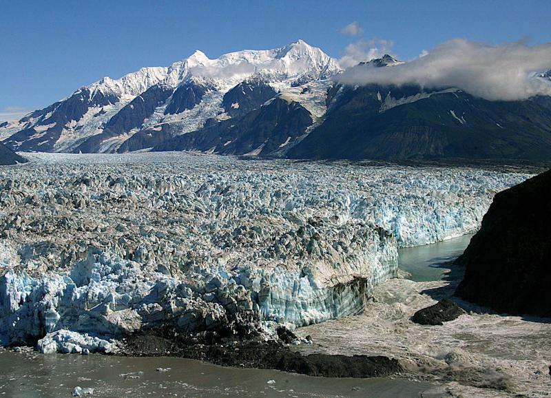 FILE - In this Aug. 14, 2002 file photo, water from the Russell Fjord spills out of a channel past the Hubbard Glacier near Yakutat, Alaska. Federal scientists are recommending rules that could restrict cruise ship visits to Alaska's Hubbard Glacier near Yakutat. The report concludes cruise ships may threaten harbor seals, a marine mammal important to Native Alaskan subsistence hunters. (AP Photo/Al Grillo, File)