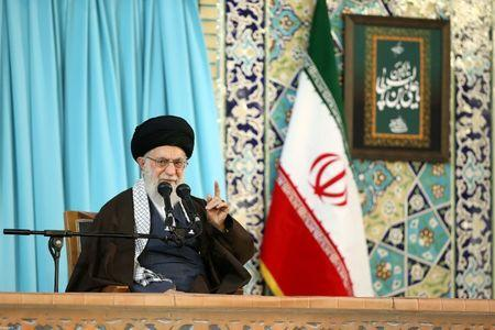 Iran's Supreme Leader Ayatollah Ali Khamenei gestures as he delivers a speech in Mashad