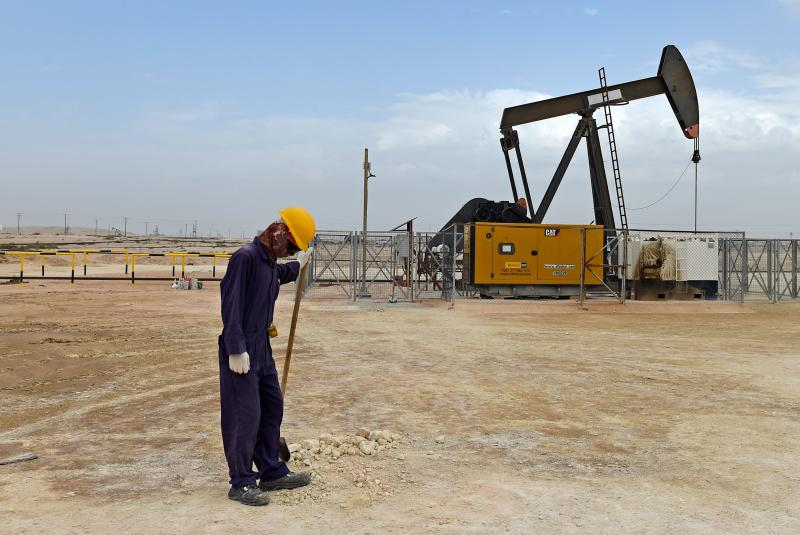 A worker stands across a pumpjack operating in the desert oil fields of Sakhir in southern Bahrain on April 22, 2020. (Photo by Mazen Mahdi / AFP) (Photo by MAZEN MAHDI/AFP via Getty Images)