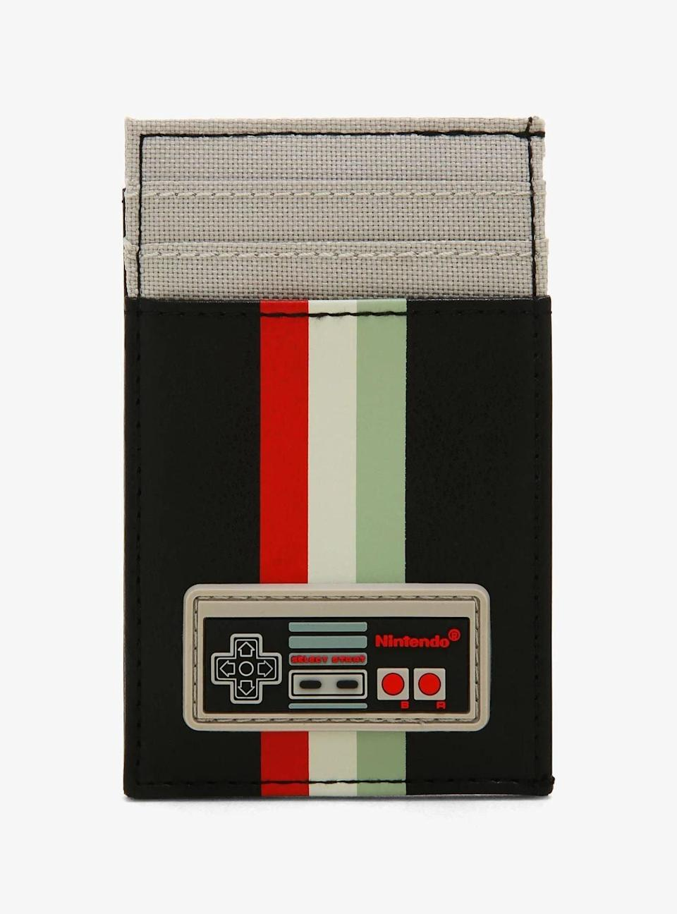 <p>This <span>Nintendo NES Controller Cardholder</span> ($17) will delight a gamer who has a sweet spot for their old Nintendo NES.</p>