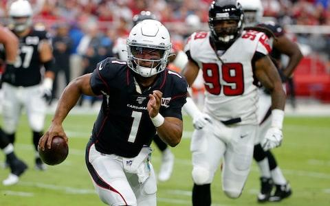 Arizona Cardinals quarterback Kyler Murray (1) scrambles as Atlanta Falcons defensive end Adrian Clayborn (99) pursues during the first half of an NFL football game, Sunday, Oct. 13, 2019, in Glendale, Ariz - Credit: AP
