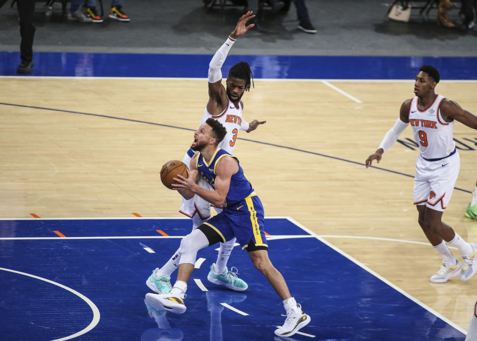 Golden State Warriors guard Stephen Curry moves past New York Knicks center Nerlens Noel (3) during the first quarter of an NBA basketball game Tuesday, Feb. 23, 2021, in New York. (Wendell Cruz/Pool Photo via AP)