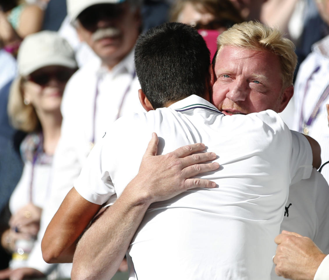 "FILE - In this July 6, 2014, file photo, Novak Djokovic, of Serbia, celebrates with his coach Boris Becker, right, in the players box after defeating Roger Federer of Switzerland in the men's singles final at the All England Lawn Tennis Championships in Wimbledon, London. Djokovic says he and coach Boris Becker are splitting up after three seasons together. Djokovic posted a statement on Facebook on Tuesday, Dec. 6, 2016, saying the duo ""jointly decided to end our cooperation."" (AP Photo/Pavel Golovkin, File)"