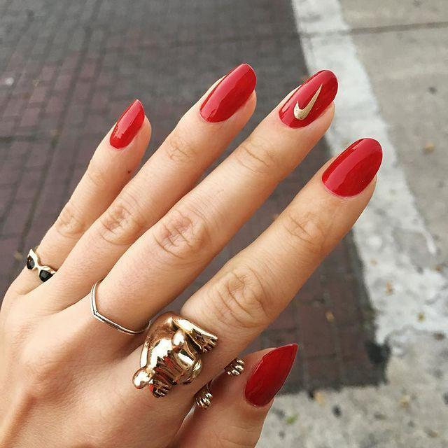 "<p>Add a hidden twist to classic red nails with a sneaky gold Nike swoosh that's still safe for work.</p><p><a href=""https://www.instagram.com/p/BbKOO2JAEBP"" rel=""nofollow noopener"" target=""_blank"" data-ylk=""slk:See the original post on Instagram"" class=""link rapid-noclick-resp"">See the original post on Instagram</a></p>"