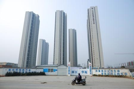 China's home price growth at weakest in nearly a year, developers seen cutting prices
