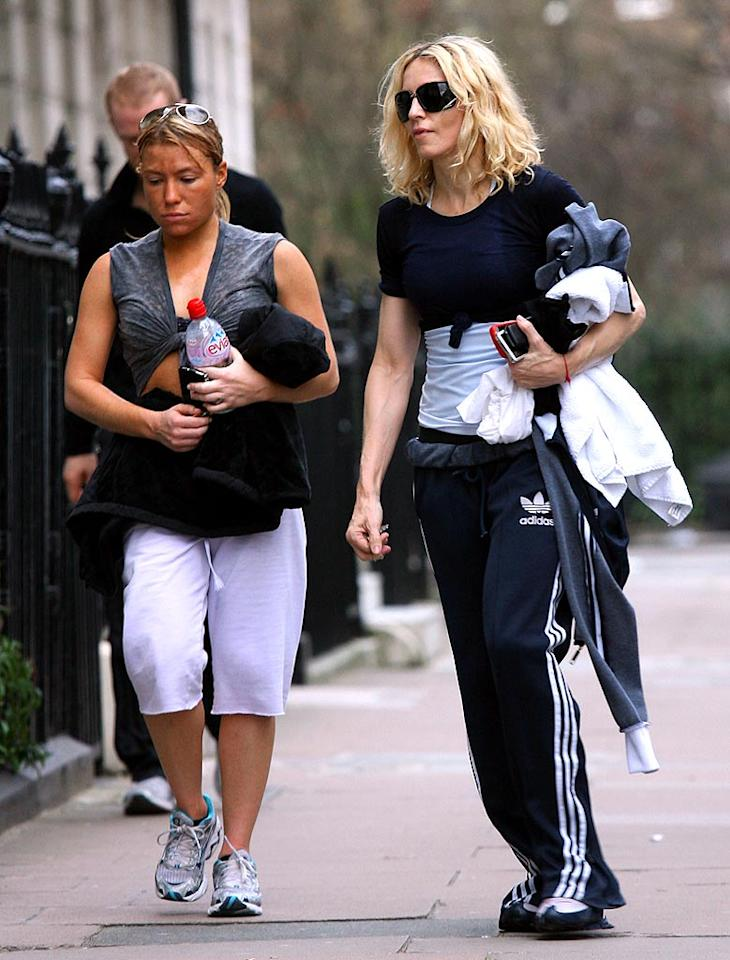 """Madonna sported a pair of of oversized shades while walking to the gym Wednesday. The fitness fanatic didn't have to go far -- she bought the house right next door and converted it to a fitness facility. The price? A cool $12 million. Colin MacFarlane/<a href=""""http://www.splashnewsonline.com"""" target=""""new"""">Splash News</a> - January 25, 2008"""