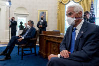 FILE - In this April 19, 2021, file photo Sen. John Hoeven, R-N.D., Sen. Mitt Romney, R-Utah, and Rep. Charlie Crist, D-Fla., attend a meeting with President Joe Biden and other members of congress to discuss his jobs plan in the Oval Office of the White House in Washington. Crist, a former Republican governor who is now a Democrat, announced his campaign for Florida governor. (AP Photo/Andrew Harnik, File)