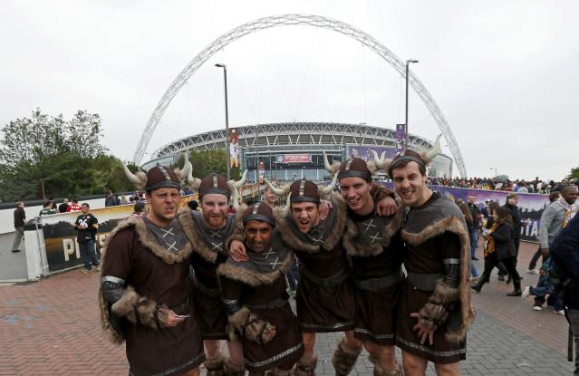 Fans from England dressed as vikings, pose for a picture before the Minnesota Vikings met the Pittsburgh Steelers in their NFL football game at Wembley Stadium in London, September 29, 2013. REUTERS/Suzanne Plunkett (BRITAIN - Tags: SPORT FOOTBALL)